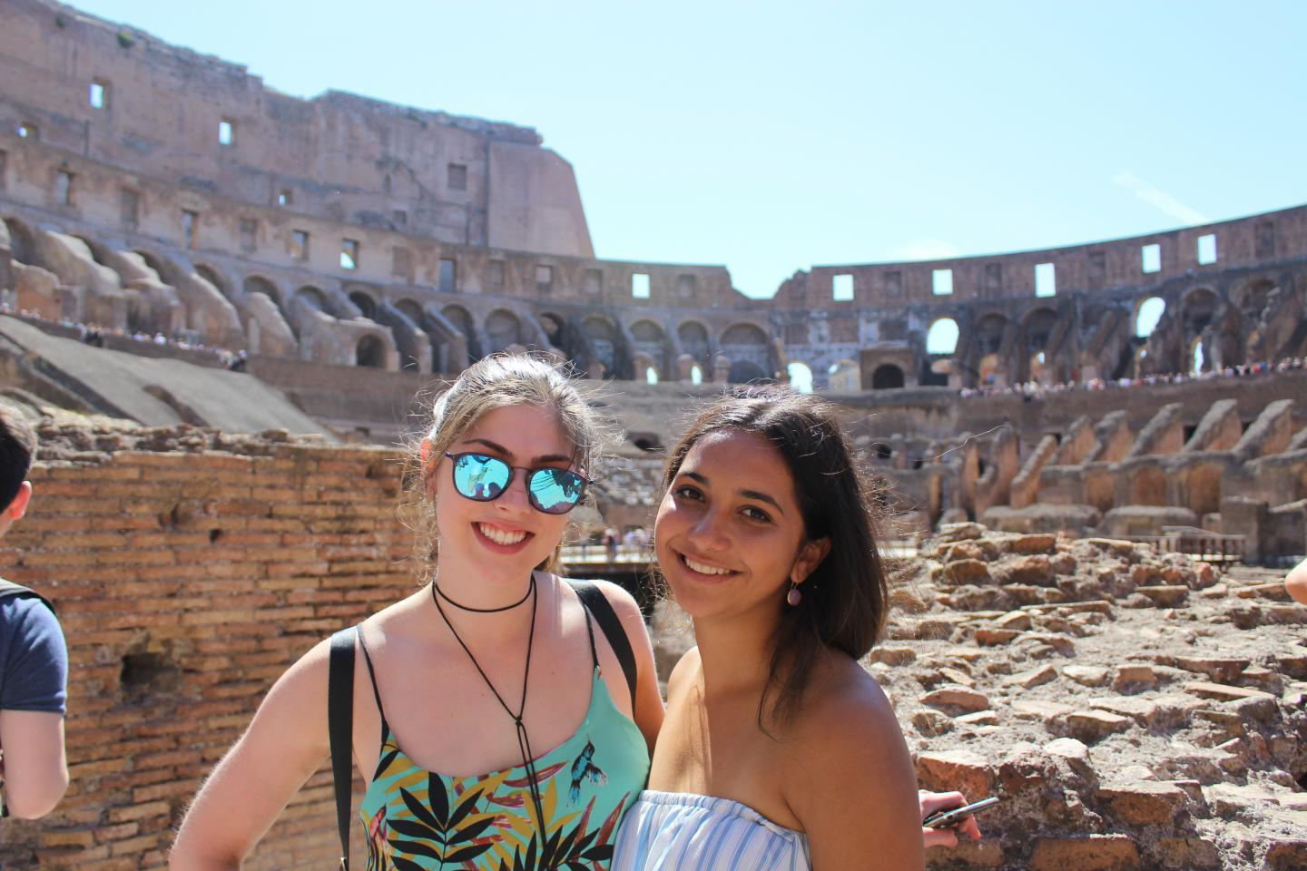 High school students smile in the Colosseum in Rome during their summer tour in Italy, Europe