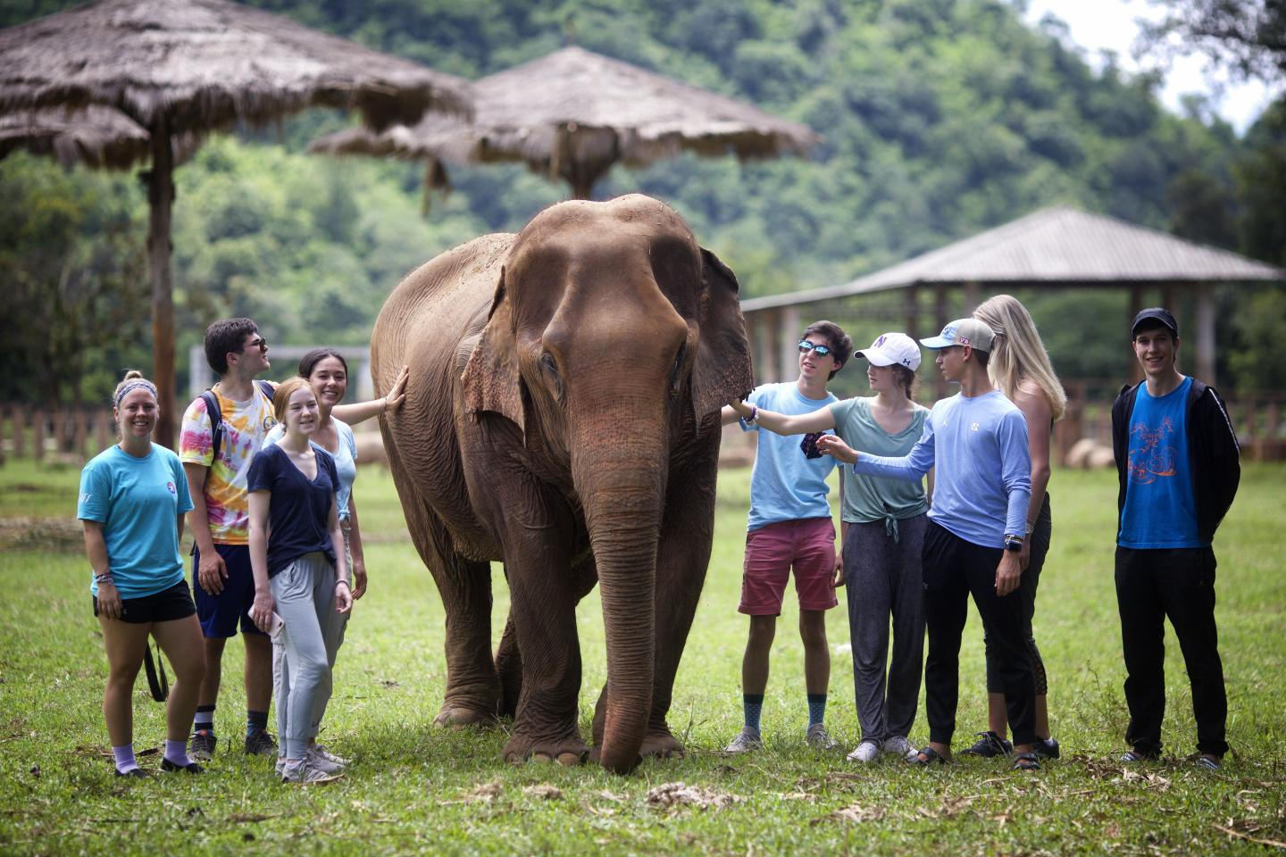 Youth travelers helping communities during teen volunteer program in thailand