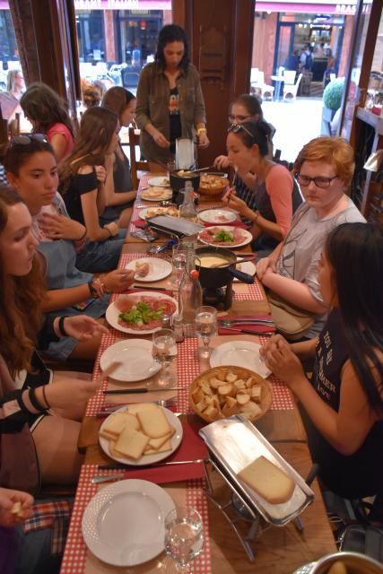 High school teens eat a local meal in Paris during their summer tour in France