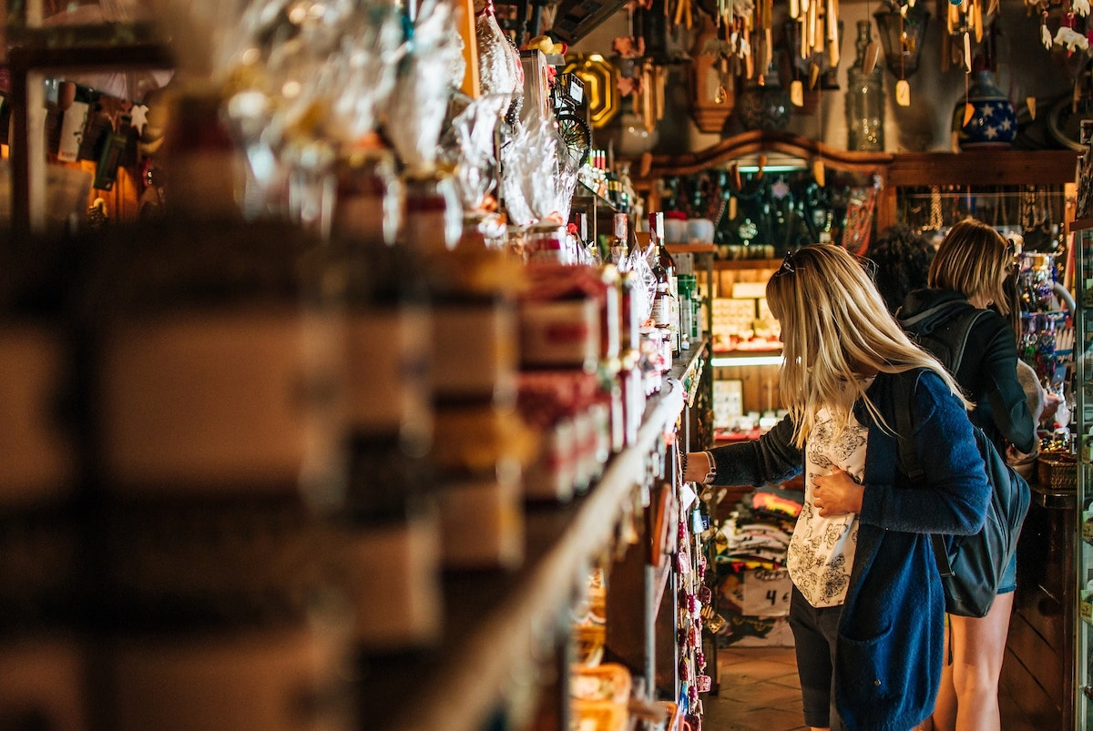 Girl Buying Souvenirs while Traveling Abroad
