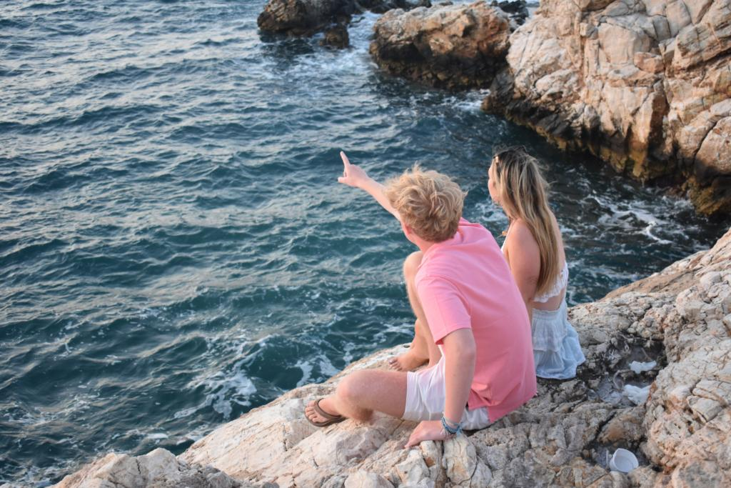 two students traveling through Italian coast looking out at ocean