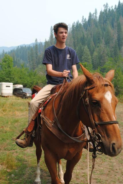 A boy on a horse in America