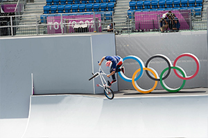 Justin Dowell completes a tailspin in air during the Men's BMX Freestyle seeding. Photo: Casey Gibson