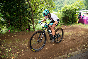 Kate Courtney climbing towards the Chopsticks section of the Women's XC course. Photo: Casey Gibson