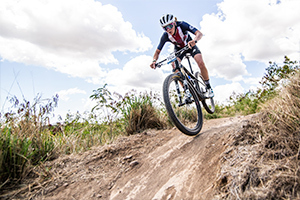 Ruth Holcomb descending during the Junior Women's XC.
