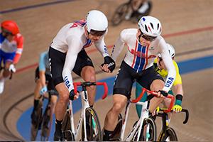Adrian Hegyvary & Gavin Hoover exchange in the Men's Madison in Tokyo. Photo: Casey Gibson