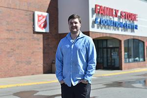 Bryan poses outside a Salvation Army Store