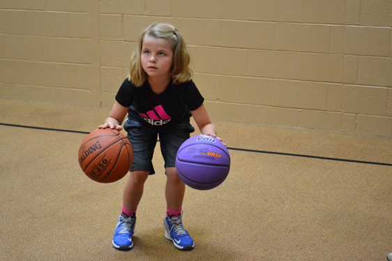 Young girl practicing dribbling
