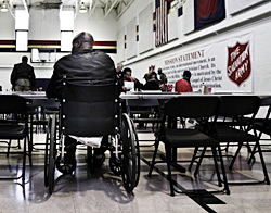 Man in a Wheelchair Receiving Assistance at a Salvation Army Center