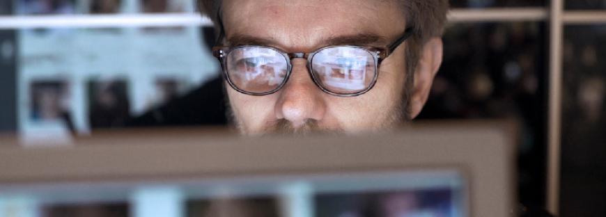 man behind a computer