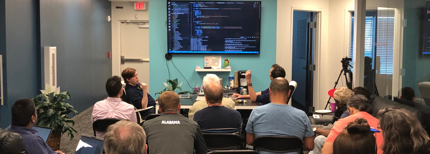 Presenters in front of an audience at the Node.js meetup