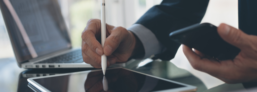 man digitally signing on a tablet