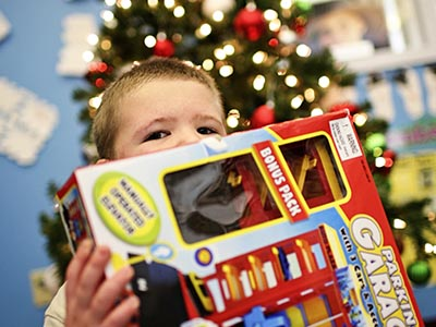 Boy Opening Present from The Salvation Army