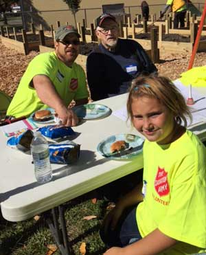 Volunteers Eating at Community Garden Building Project