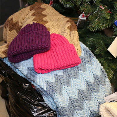 Pratt & Whitney donates gloves, mittens, hats, scarves, ear muffs, baby blankets and socks to Marshall House Family Shelter!