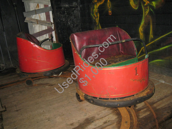 Dantes inferno  pretzel cars in neglected shape sitting motionless in the old ride at williams grove amusement park 2009