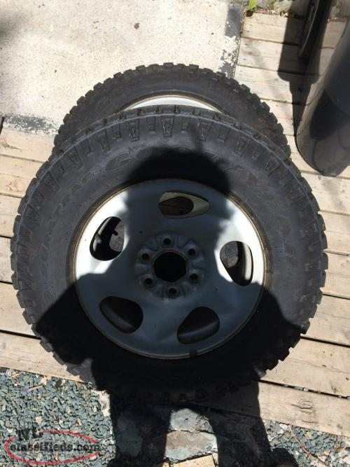 4 studded winter tires on rims for sale lt 225 75r 16 buy sell in fortune newfoundland nl. Black Bedroom Furniture Sets. Home Design Ideas