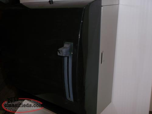 Paper towel dispenser, black, wall mount.