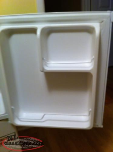 brand new mini fridge perfect for bedroom or garage