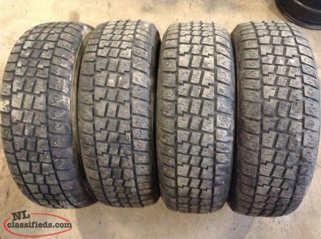 P215/65R16 Studded Snow Tires (Excellent Condition)