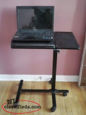 Adjustable Laptop / Netbook Table Perfect for apartment or to save space.