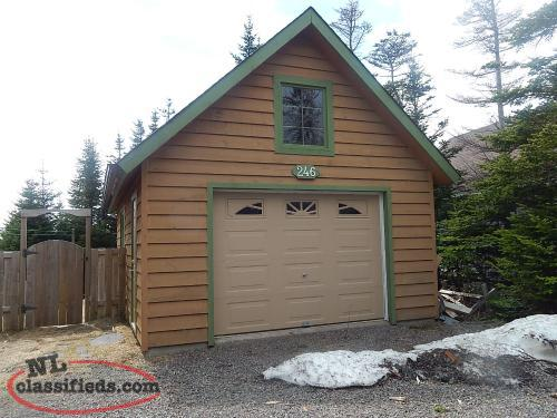 Log chalet style home with full basement to develop for Chalet style homes with attached garage