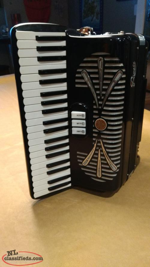 LOWERED PRICE!..Rare Vintage Rivoli Piano Accordion 120 base!!!.Sounds Beautiful