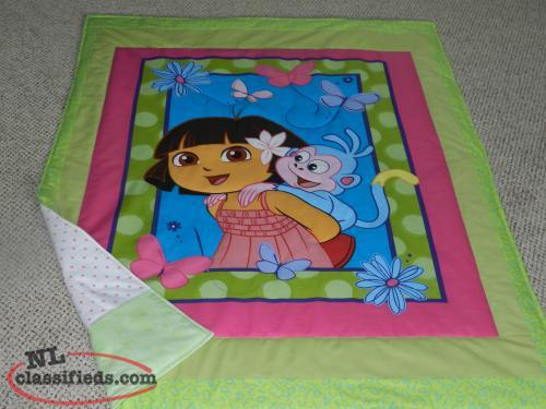 for sale a New DORA quilt with flannelette backing