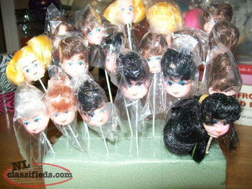 Dolls heads on wire post