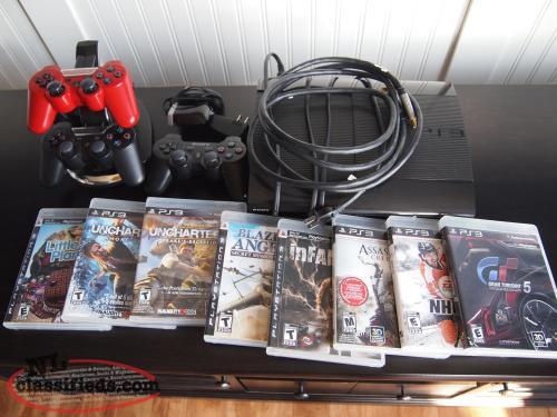 PS3 Console, games, controllers, charging dock, Logitech Harmony PS3 adapter