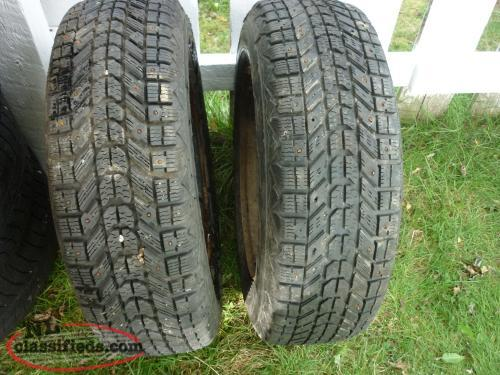 2 14IN. FIRESTONE STUDDED TIRES P195/70R14 ON 5 HOLE RIMS OFF 2005 SUNFIRE