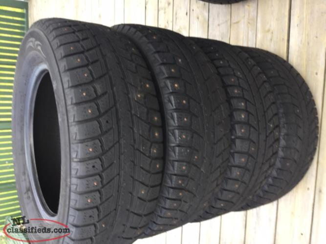 4 Winter tires studded 215 / 65 / 16