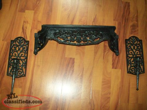 black wall sconce and shelf