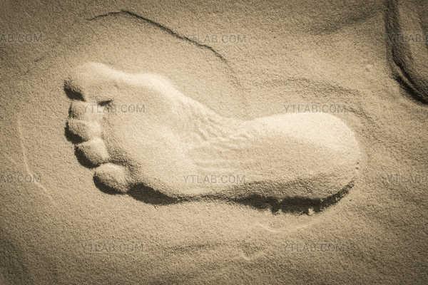 Pied dans le sable