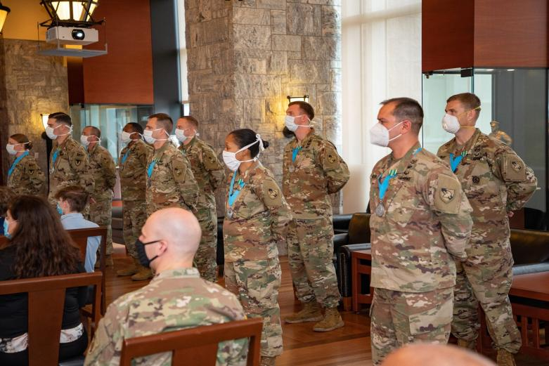Ten non-commissioned officers standing as they are inducted into the prestigious Sergeant Audie Murphy Club during a ceremony Friday in the Haig Room.