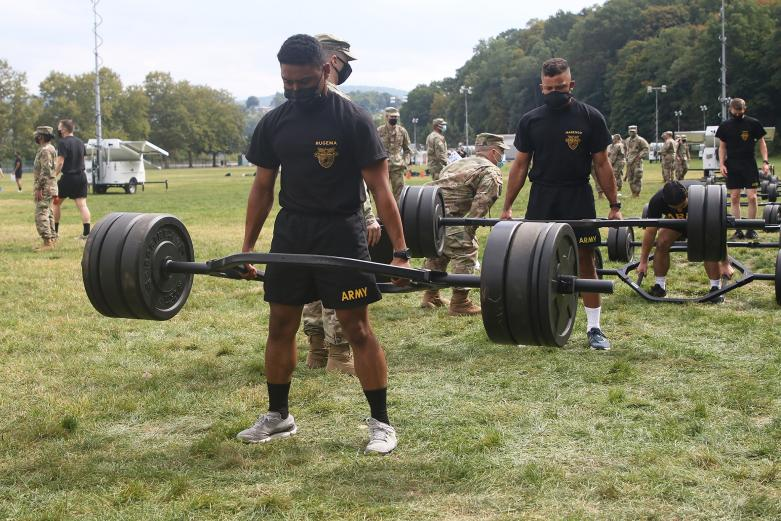 Cadets lifting weights outdoors during the Army Combat Fitness Test.