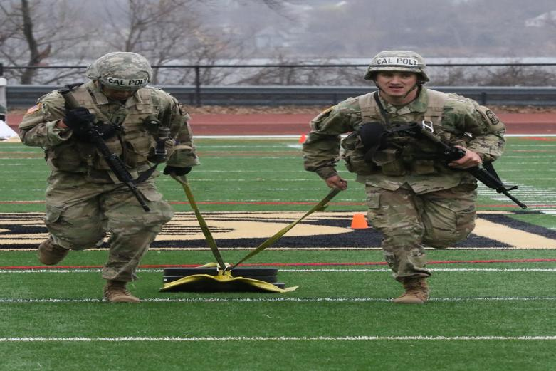 Cadets complete the weighted sled drag event during the Sandhurst competition
