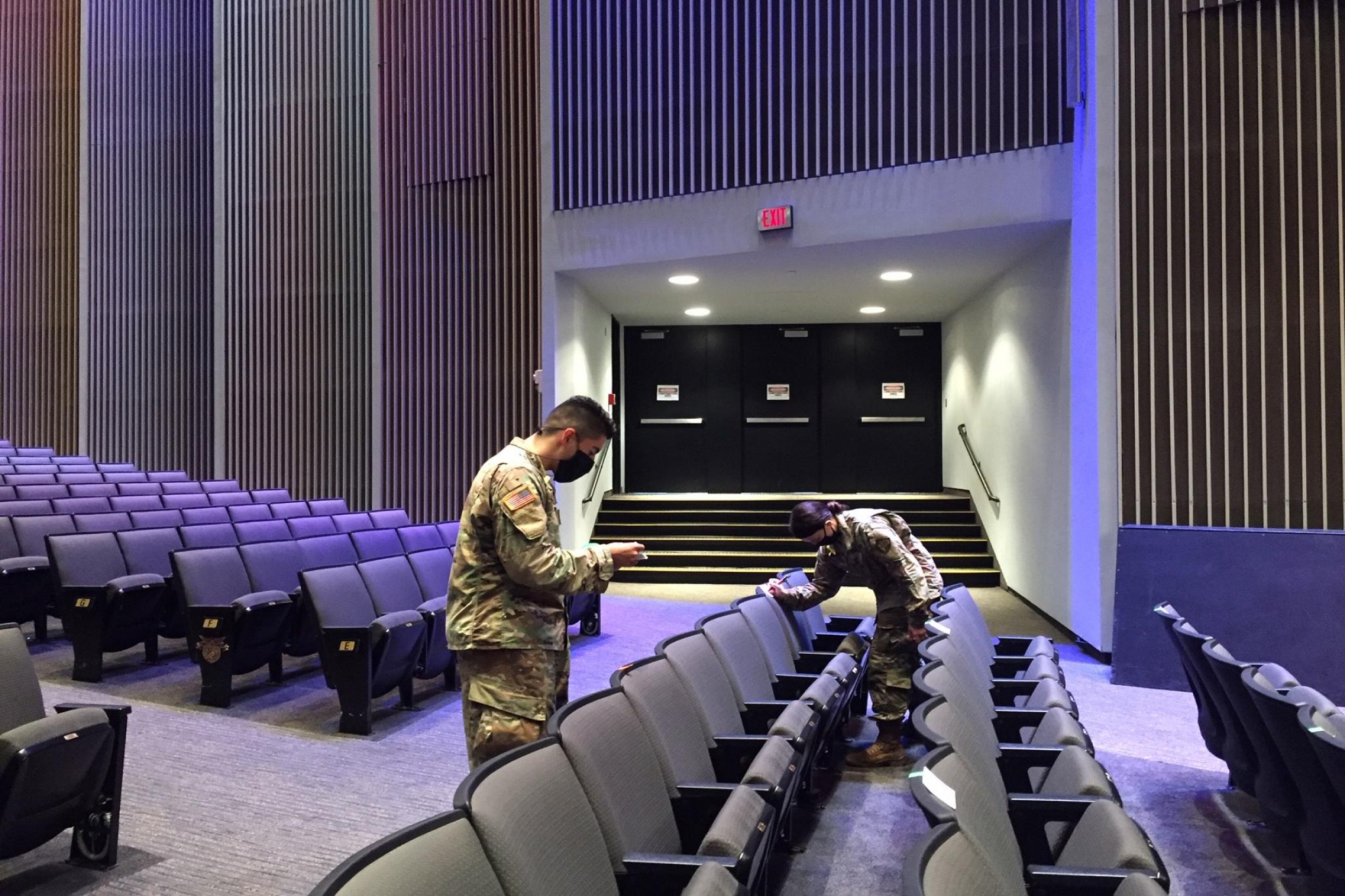 """USMA Class of 2022 Cadet Andy Rodriguez, left, and Class of 2024 Cadet Emily Hobbs, right, mark off seats in Eisenhower Hall Theatre Sept. 10 ahead of the """"We Stand Together"""" concert at the U.S."""
