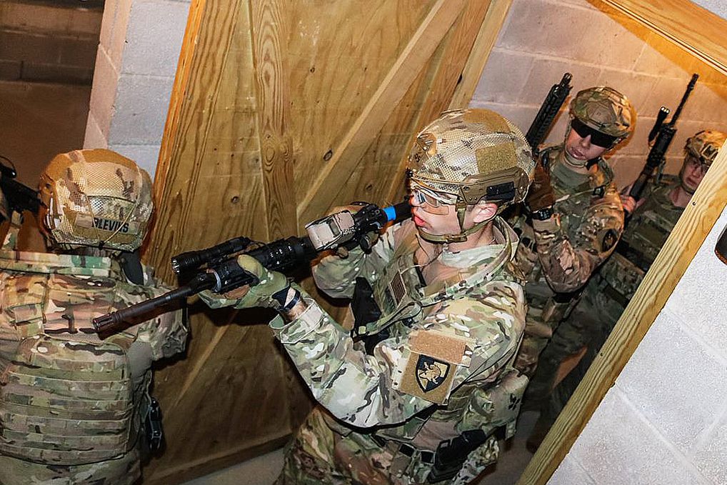 Cadets execute their close quarters strategy in the target building