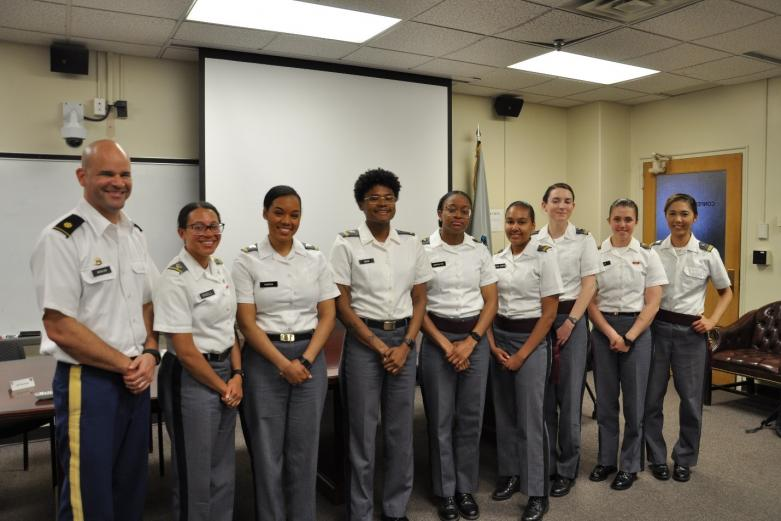 Diversity & Inclusion Students and a faculty member pose for group photo in the Behavioral Science & Leadership conference room at West Point.