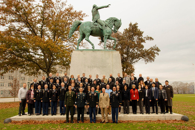 Staff and Faculty in front of statue