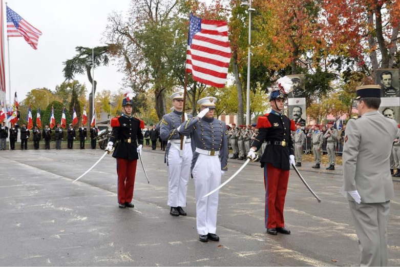 American cadets on parade in France saluting a French commander