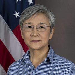 Dr Ao official photo in front of US Flag