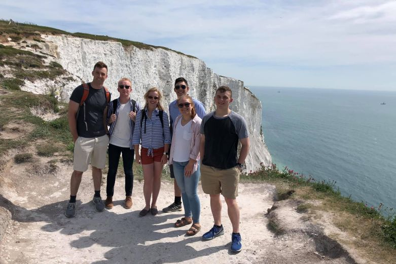 Six cadets at the Cliffs of Dover on an international trip.
