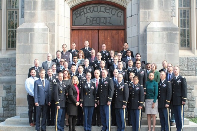 Department of Chemistry and Life Science staff and faculty members gather in front of Bartlett Hall at West Point.