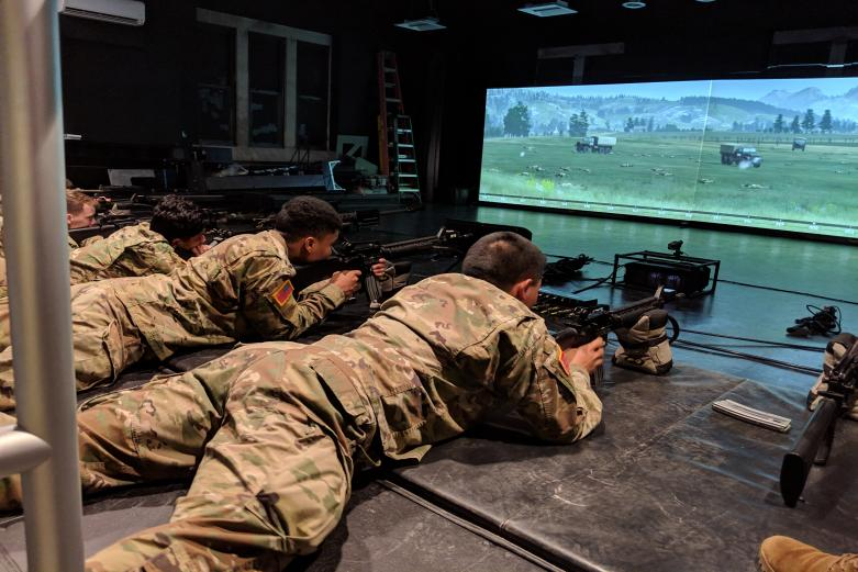 Cadets holding rifles while participating in the simulated weapons range while at the West Point Simulation Center.