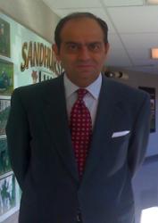 Dr Chouairi in hallway wearing a suit