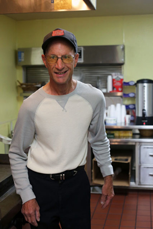 Mueller Michael Mueller stands in the kitchen of the Redondo Beach Corps where he volunteers four days a week. He has volunteered for The Salvation Army since 1987.
