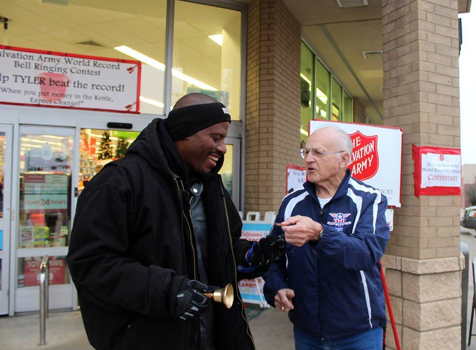 Volunteer Andre Thompson of Tyler, TX receives a donation from a WWII veteran.