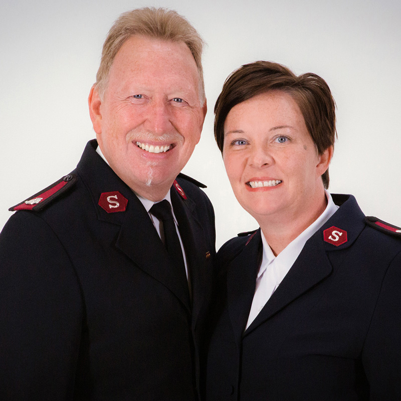 Smiling man and woman in uniform